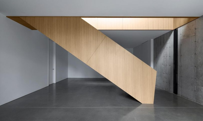 Main staircase with concrete floors
