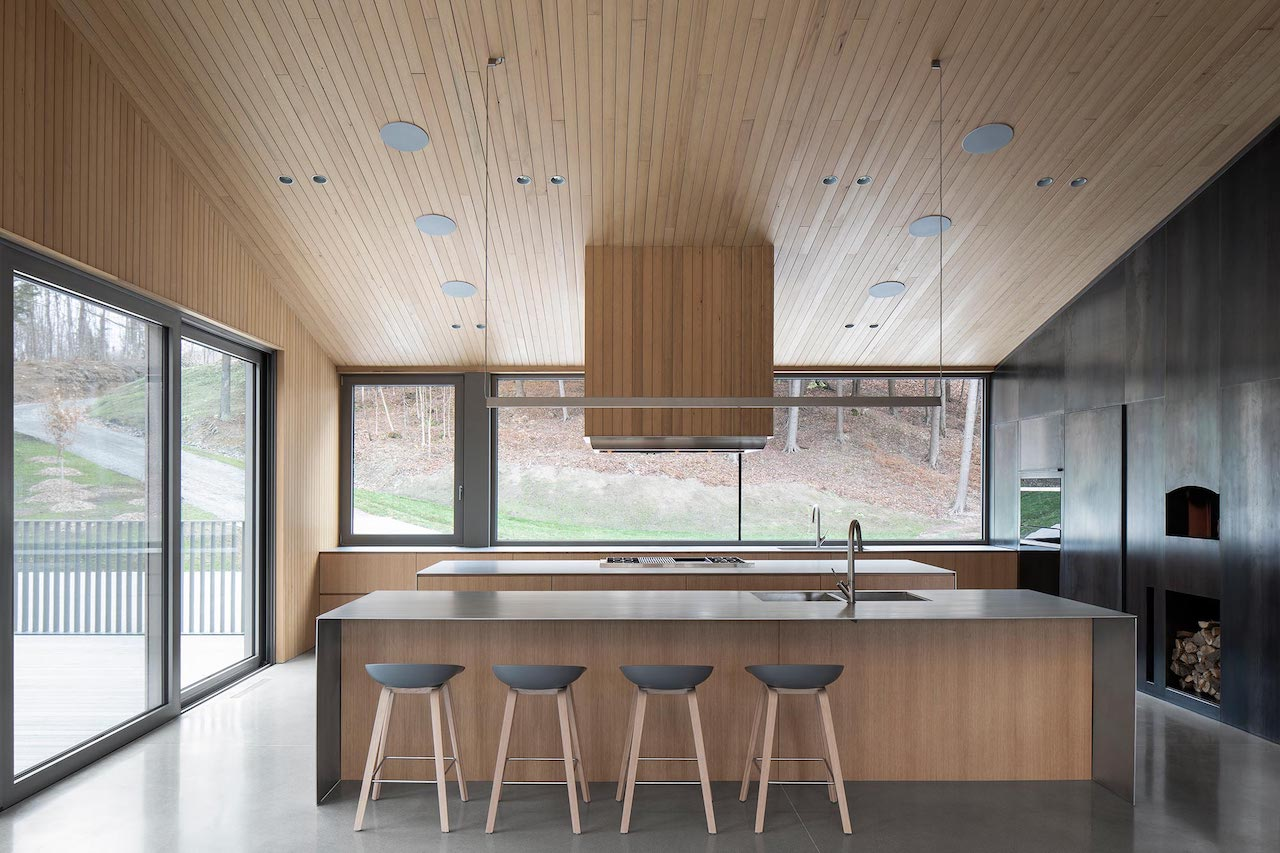 A Modern Lake House in Quebec Composed of Three Volumes