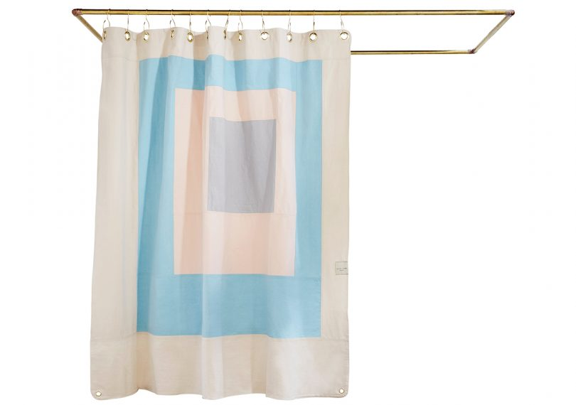 Quiet Town Marfa Sky Shower Curtain hanging on shower curtain rod, on white background