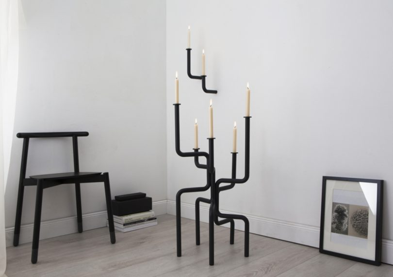 Roijé walk of flame candle holder in a living room