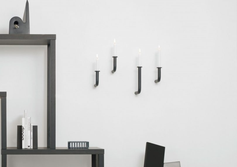 Roijé Wall of Flame candle holders on a wall in a living room