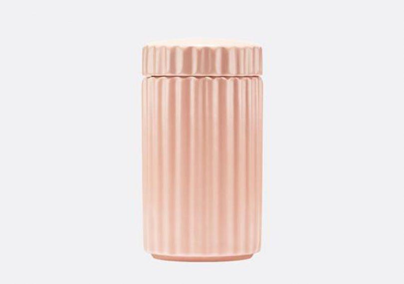 Waggo rippled ceramic dog treat jar on light grey background