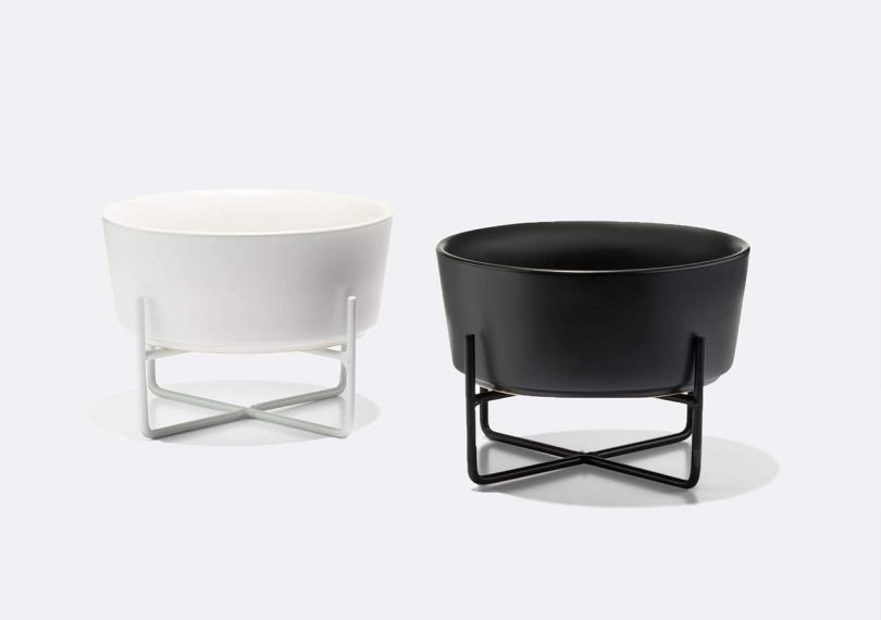waggo simple solid dog bowl and stand in black and white on a light grey background