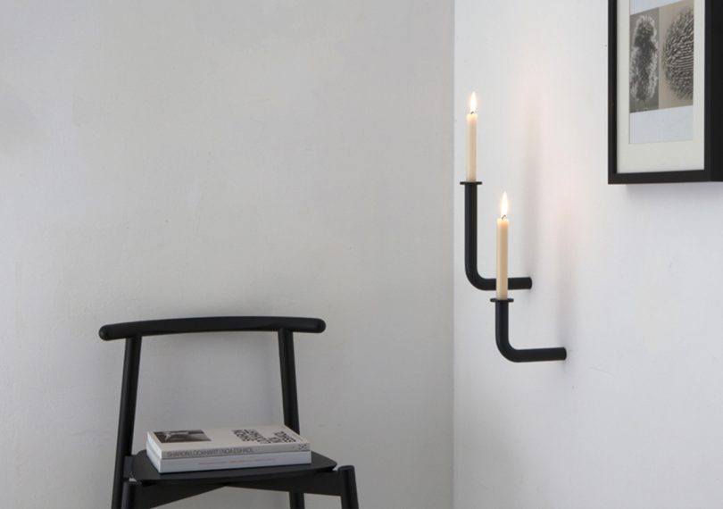 Roijé Wall of Flame candle holders mounted on a wall in a living room