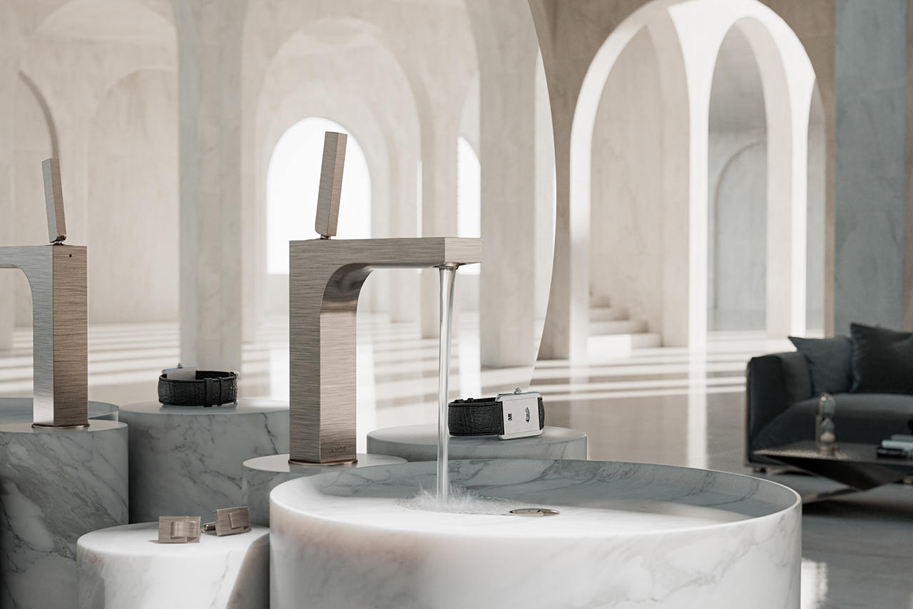 angular silver metal bathroom faucet turned on and flowing into marble sink