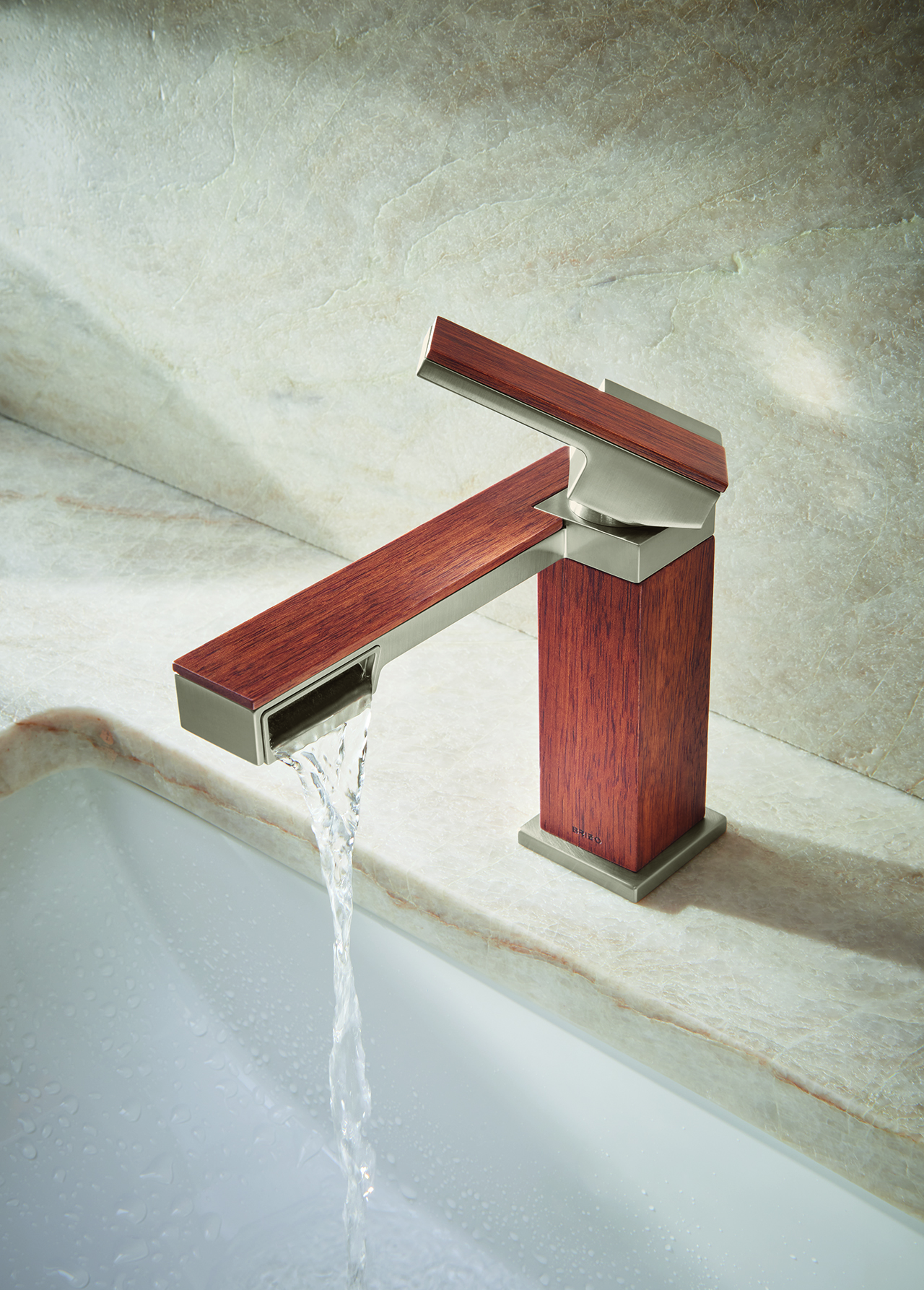 single handlr faucet in teak wood and metal turned on and flowing into sink