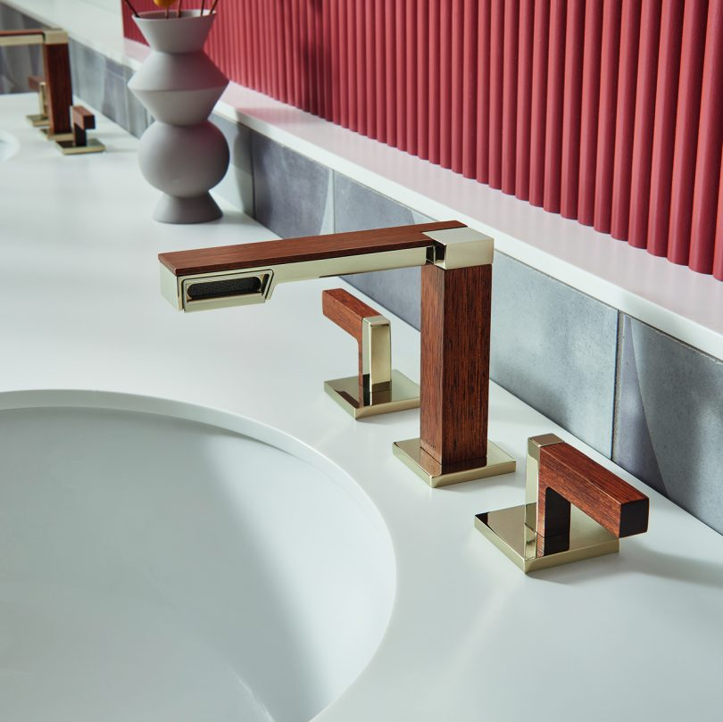 wide set faucet installed in marble counter