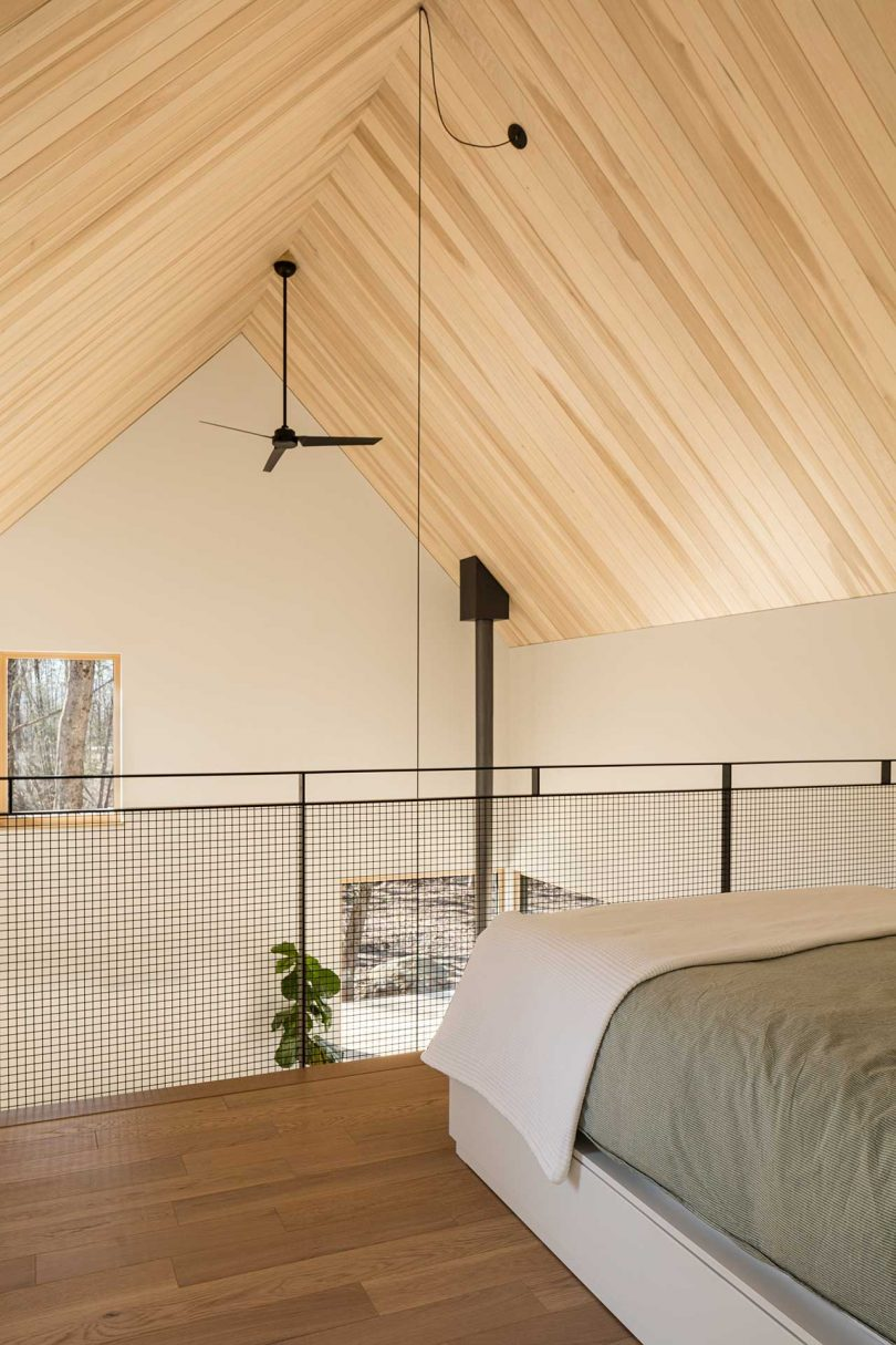 view from loft bedroom in modern cabin overlooking living space