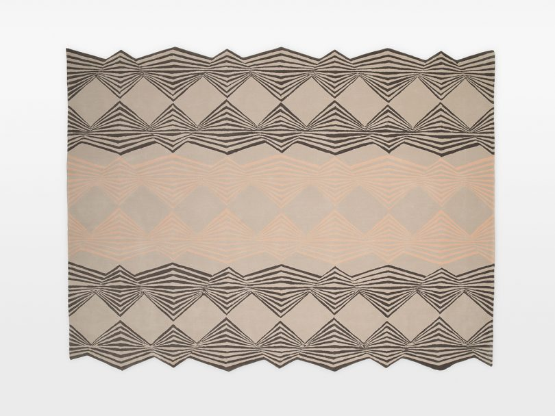 beige and grey patterned floor rug on white background