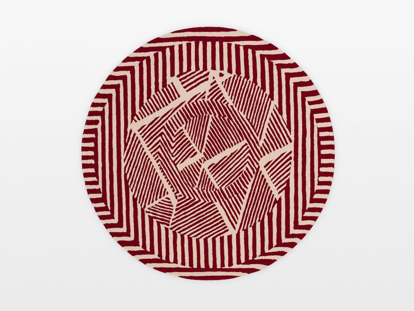 round red and white floor rug with a geometric pattern on white background