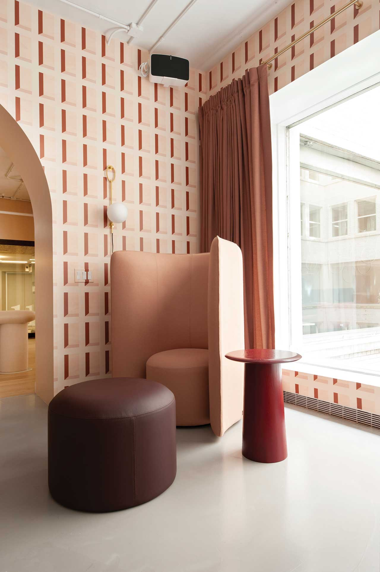 modern showroom corner with tall upholstered chair for privacy