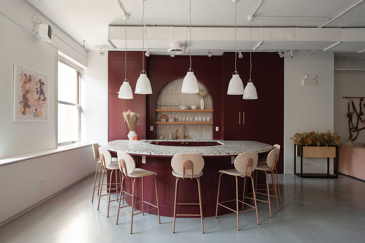modern showroom featuring a burgundy bar with light colored stools