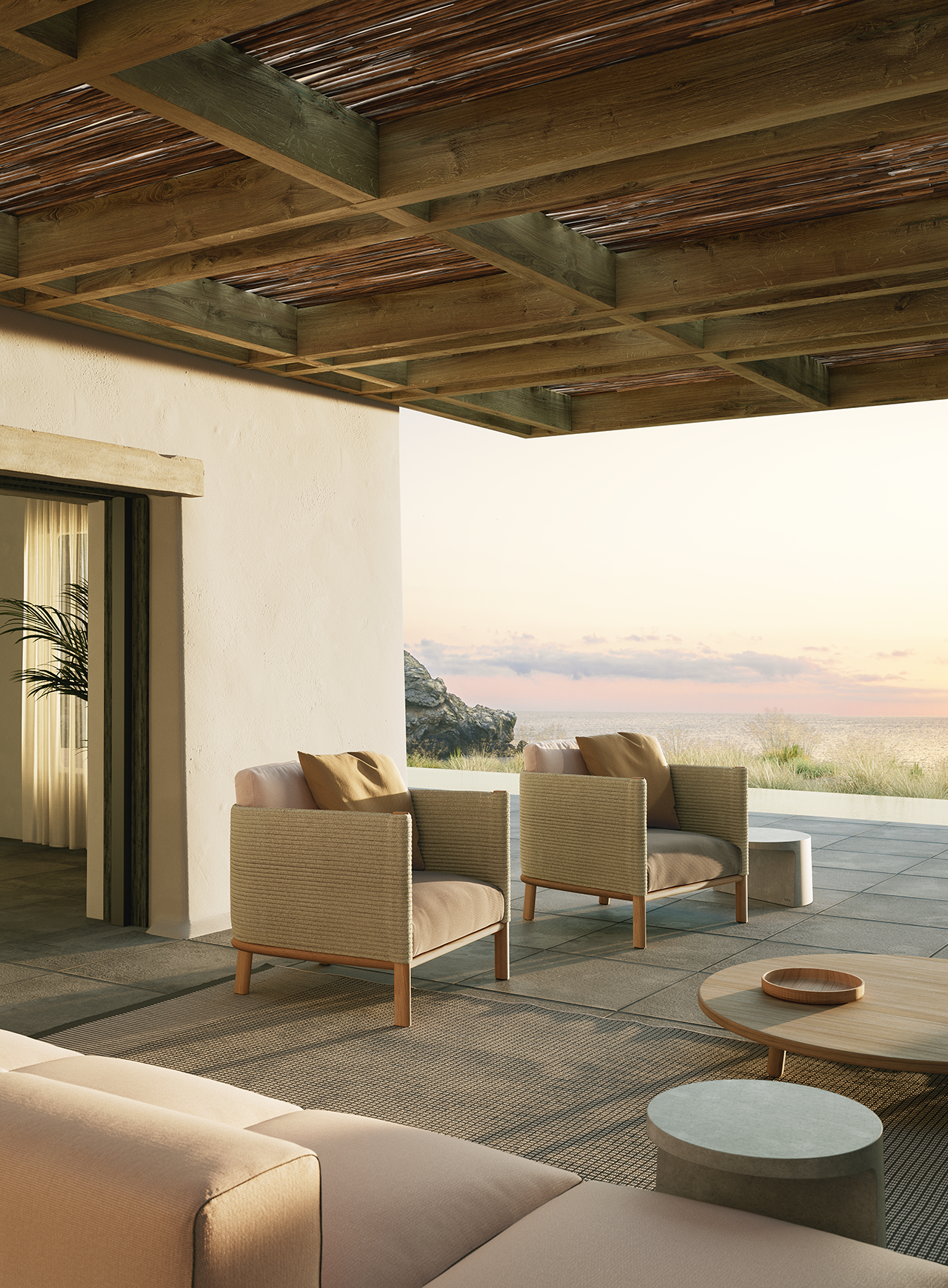 two boxy outdoor chairs sitting on a covered outside patio