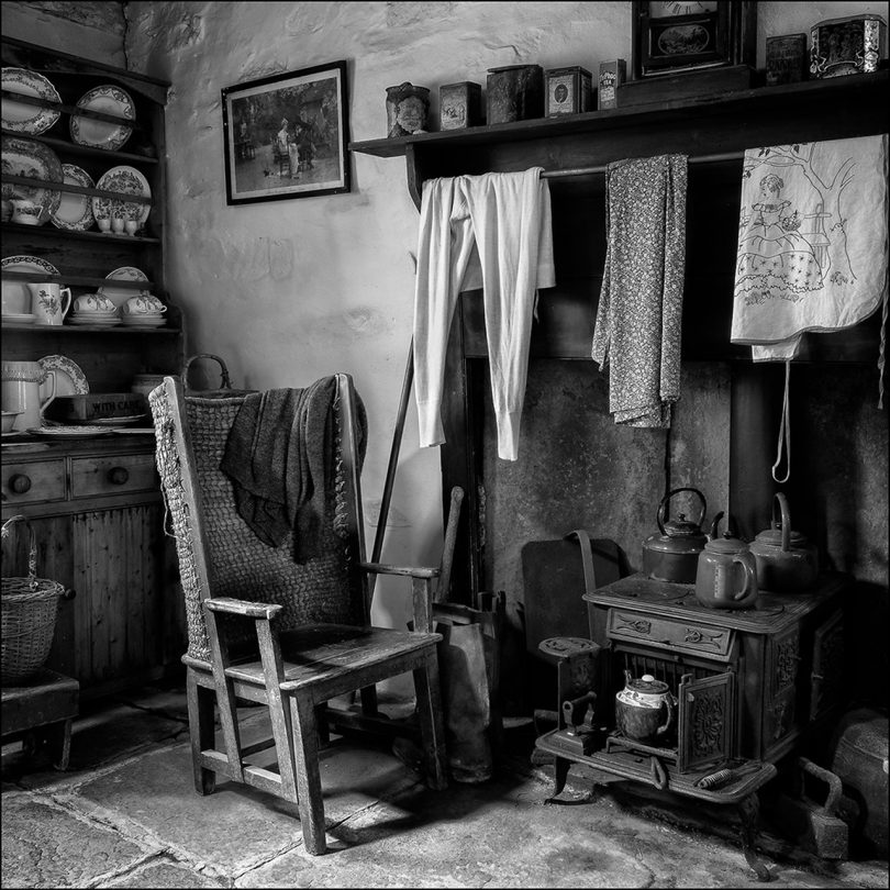 black and white image of an armchair indoors