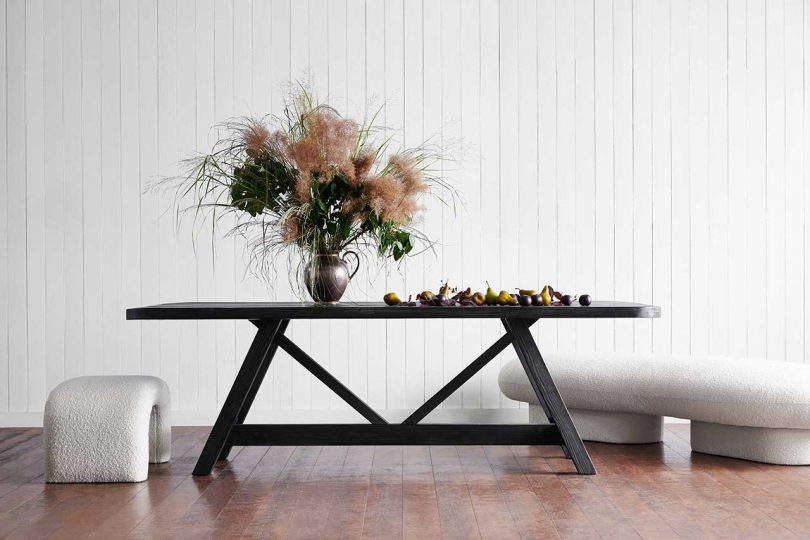 black dining table with white backdrop