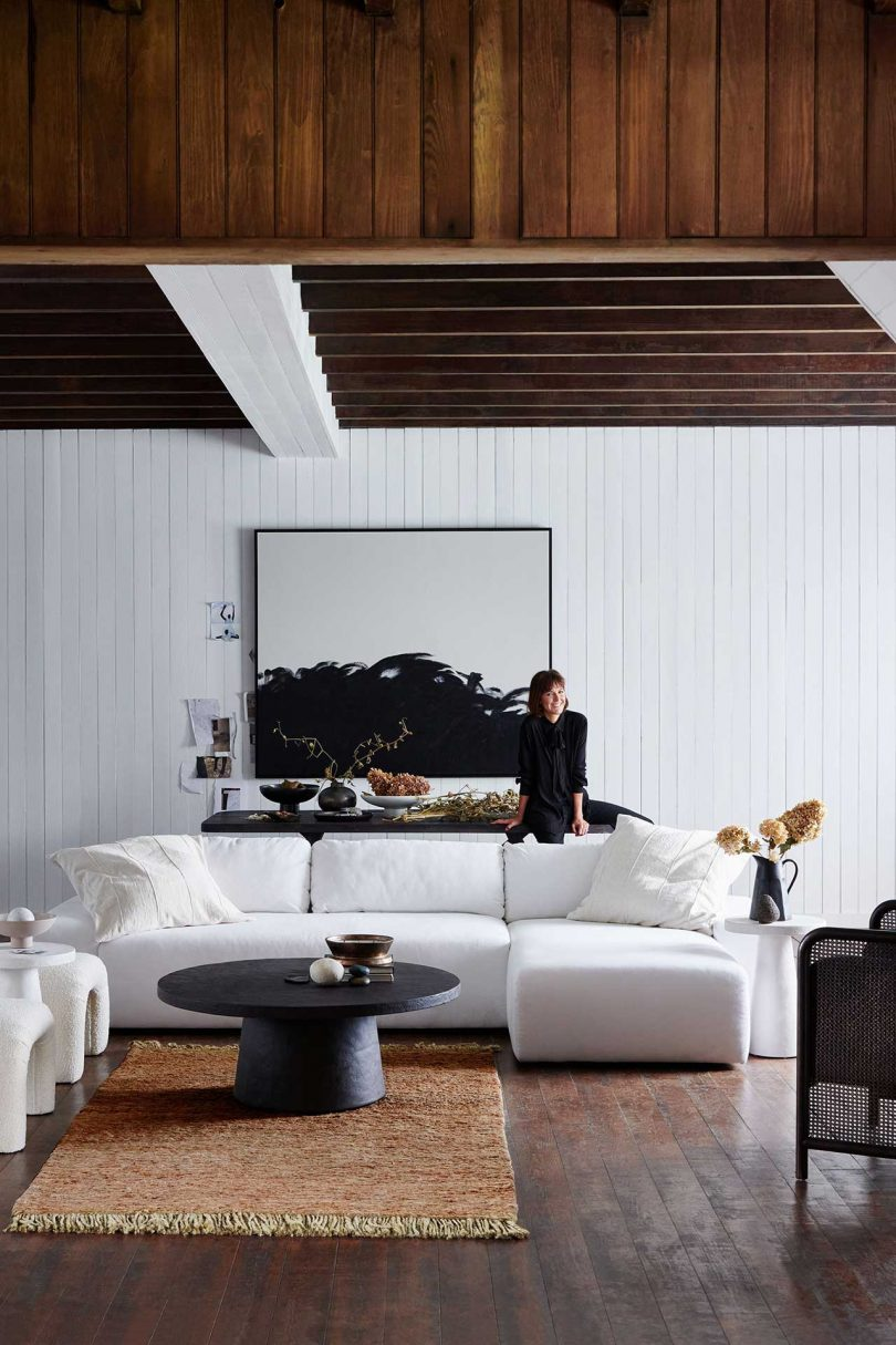 contemporary living room with white sofas and Leanne Ford