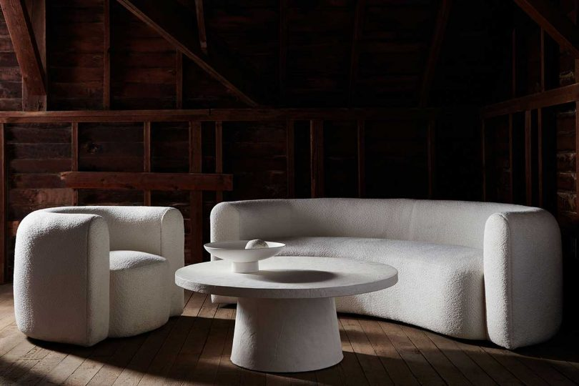 dark space with rounded white sofa and chair