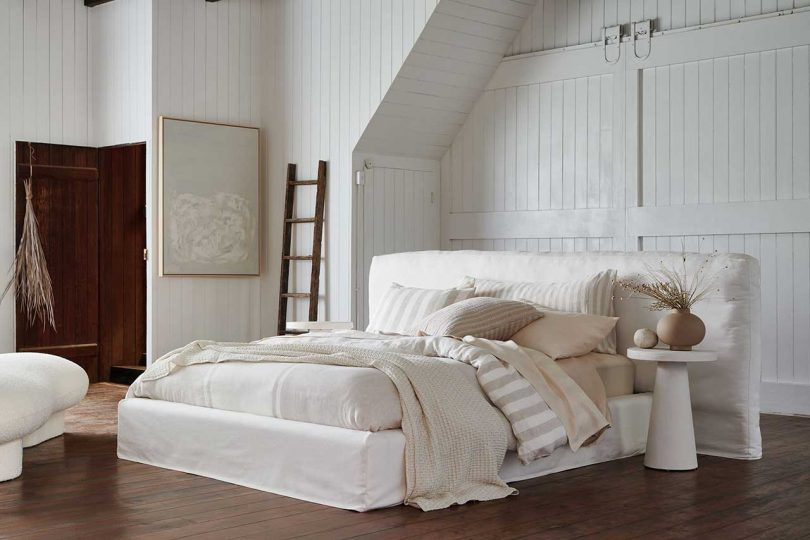 white bedroom with white upholstered bed