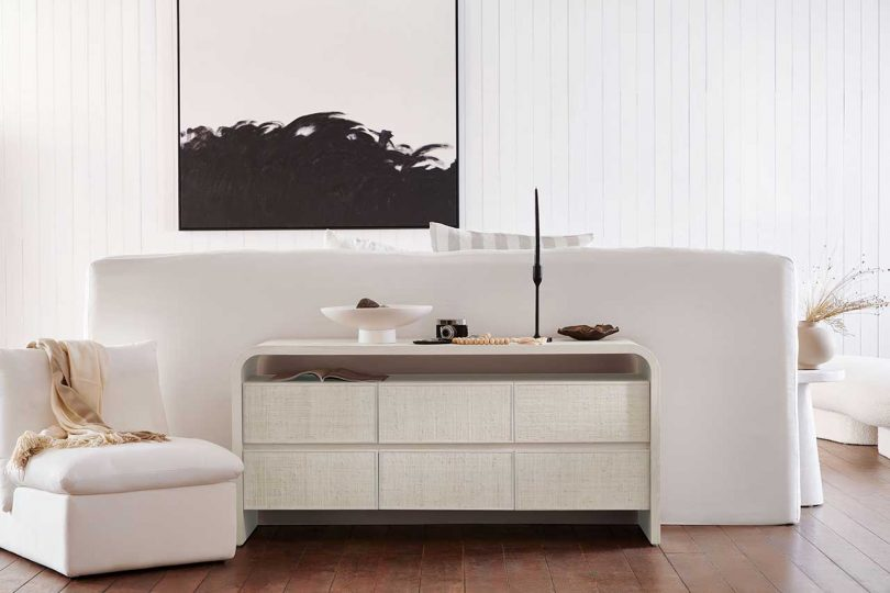 white bedroom with white console dresser