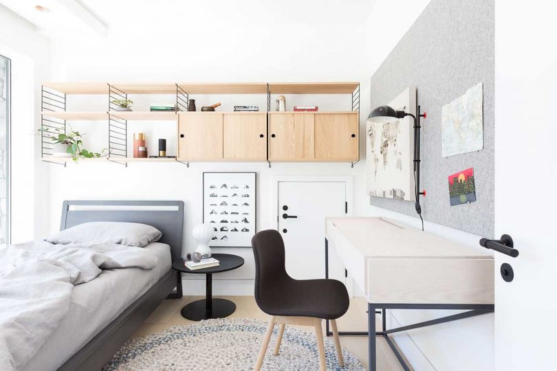 modern bedroom for child with gray, black and white decor