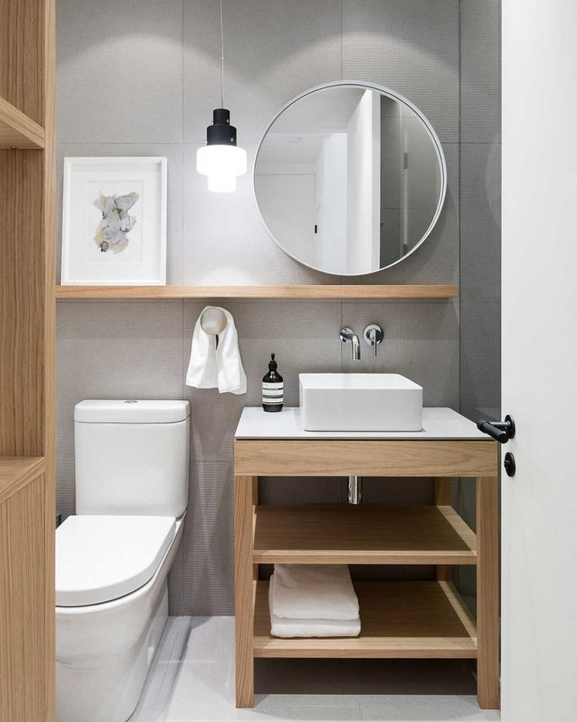 modern bathroom with wood and white fixtures