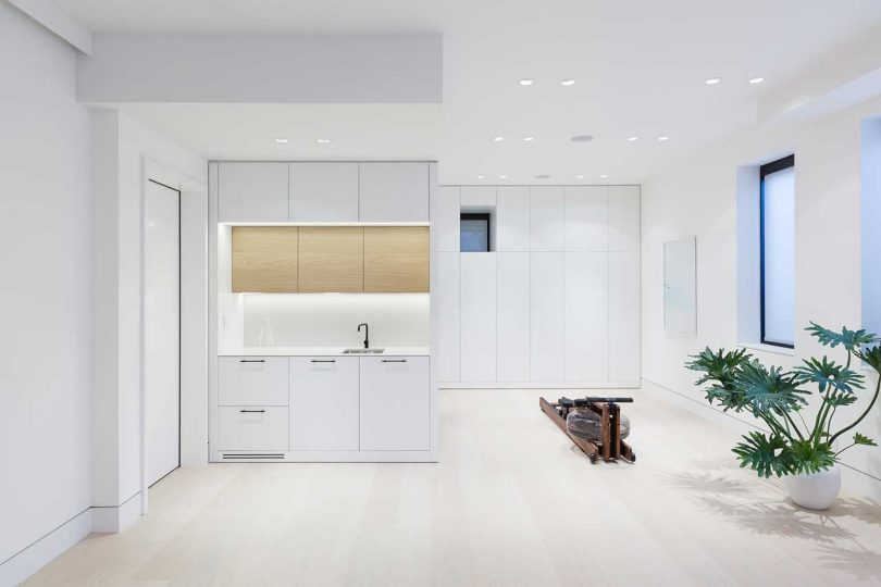 modern bonus living space with kitchenette and exercise bike