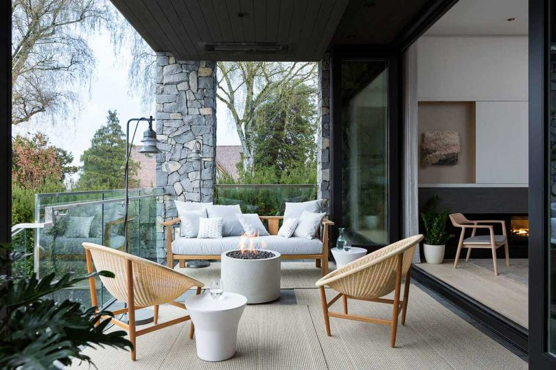 outdoor terrace with seating off modern living room