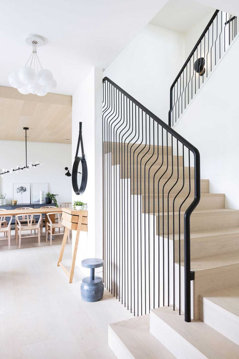 interior view of modern staircase looking into dining room