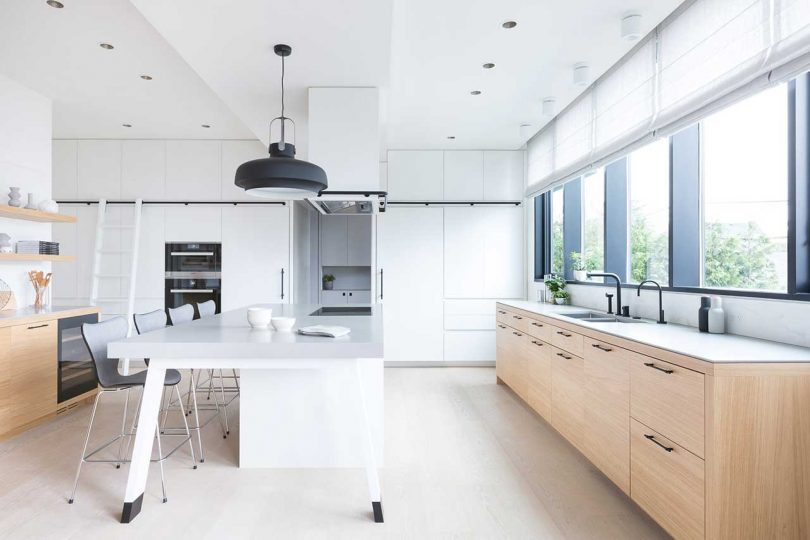 modern black and white kitchen with wood accents