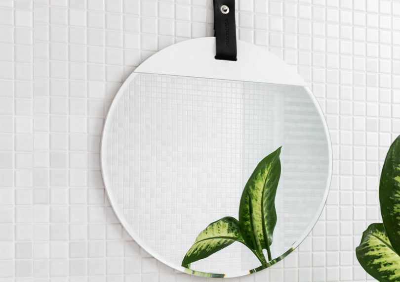 Reflect mirror in white by cloudnola hung on a white tiled wall