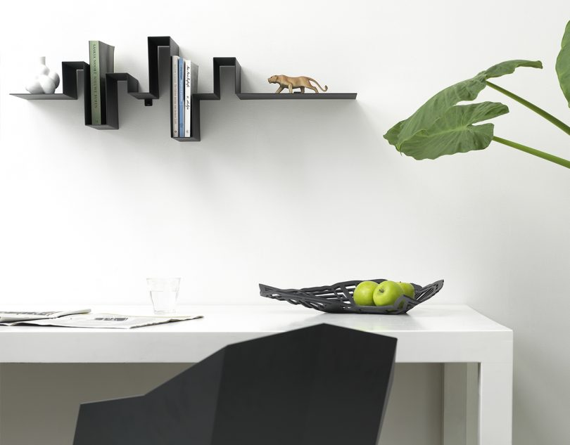 Roije Storylines wall shelf in a home office above a desk and chair