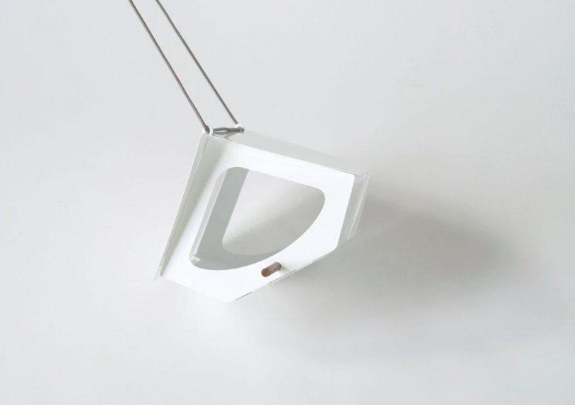 Beekman Aluminum bird feeder by shift on a light grey background