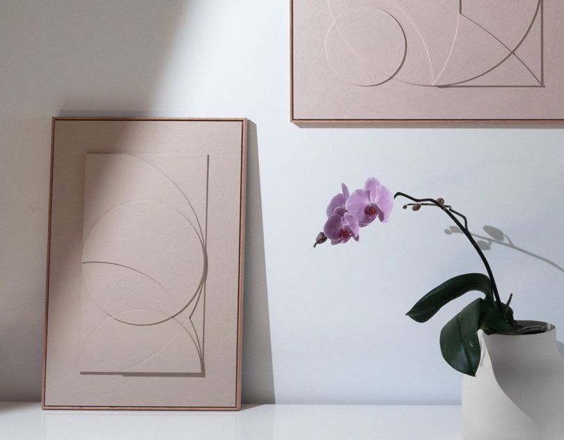 TOO designs sureen gouws art collection on table and on a wall